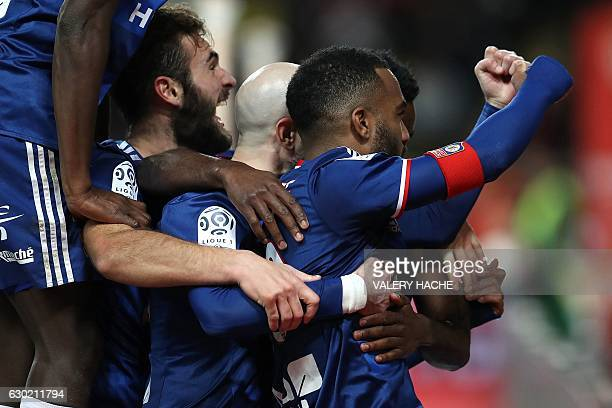 Lyon's French forward Alexandre Lacazette celebrates with teammates after scoring a goal during the French L1 football match between AS Monaco and...