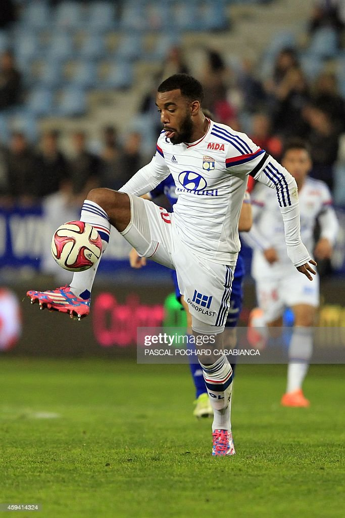 Lyon's French forward Alexandre Lacazette controls the ball during the French L1 football match Bastia (SCB) against Lyon (OL) on November 22, 2014 in the Armand Cesari stadium in Bastia, French Mediterranean island of Corsica.