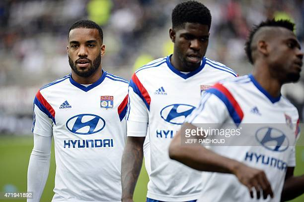 Lyon's French forward Alexandre Lacazette gather with teammates before the French L1 football match between Lyon and Evian on May 2 at the Gerland...