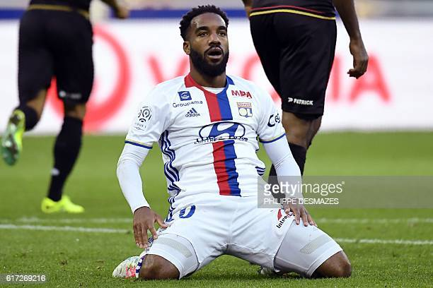 Lyon's French forward Alexandre Lacazette reacts after losing a goal during the French L1 football match between Olympique Lyonnais and EA Guingamp...