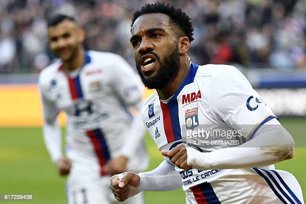 Lyon's French forward Alexandre Lacazette reacts after scoring a goal during the French L1 football match between Olympique Lyonnais and EA Guingamp...