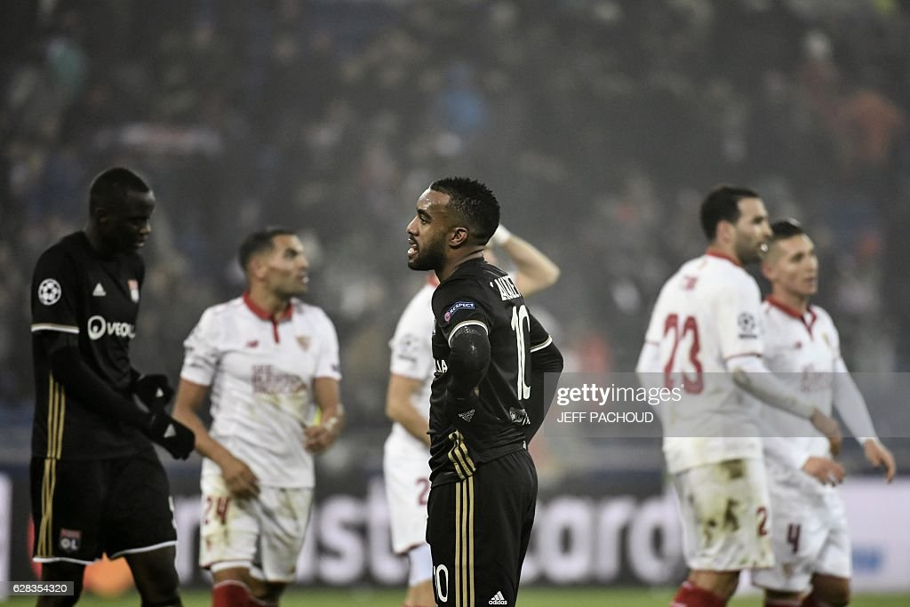 Lyon's French forward Alexandre Lacazette (C) reacts at the end the UEFA Champions League Group H football match between Olympique Lyonnais (OL) and FC Sevilla at the Parc Olympique Lyonnais in Décines-Charpieu near Lyon, southeastern France, on December 7, 2016. Last season's Europa League winners Sevilla drew 0-0 with Lyon to take the runners-up spot in Group H. / AFP / JEFF