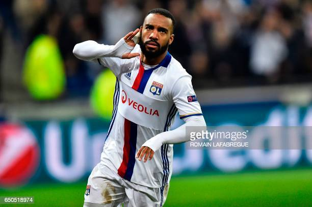 Lyon's French forward Alexandre Lacazette reacts during the Europa League round of 16 first leg football match between Lyon and AS Roma on March 9 at...