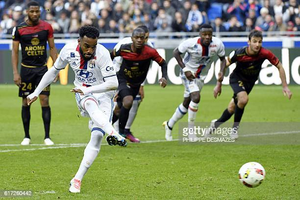 Lyon's French forward Alexandre Lacazette shoots a penalty and scores during the French L1 football match between Olympique Lyonnais and EA Guingamp...