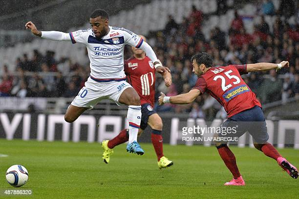 Lyon's French forward Alexandre Lacazette vies with Lille's Montenegrin defender Marko Basa during the French L1 football match between Lyon and...