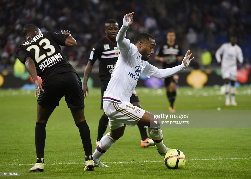 Lyon's French forward Alexandre Lacazette (R) vies with Nice's Portuguese defender Ricardo Pereira (L) during the French L1 football match Olympique Lyonnais and OGC Nice on April 15, 2016, at the New Stadium in Decines-Charpieu near Lyon, southeastern France.