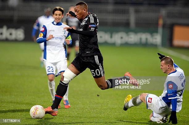 Lyon's French forward Anthony Martial vies with Kiryat Shmona's Israeli defender El'ad Gabai during the UEFA Europa League football match Olympique...
