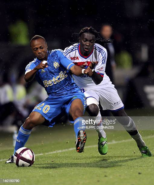 Lyon's French forward Bafetimbi Gomis fights for the ball with Marseille's Ghanaian forward Andre Ayew during the French L1 football match Lyon vs...