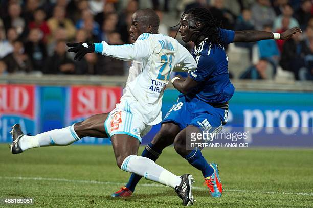 Lyon's French forward Bafetimbi Gomis scores a goal despite Marseille's Senegalese defender Souleymane Diawara during the French L1 football match...