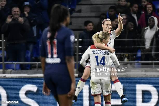 Lyon's French forward Eugenie Le Sommer celebrates after scoring a goal during the French women D1 football match between Olympique Lyonnais and...