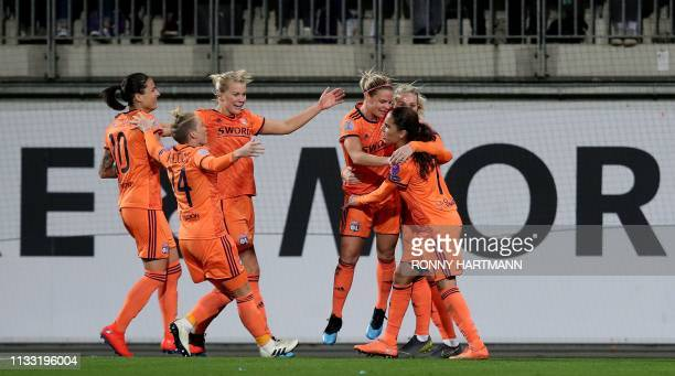 Lyon's French forward Eugenie Le Sommer celebrates after scoring the 24 goal with her teammates during the UEFA women's Champions League quarterfinal...