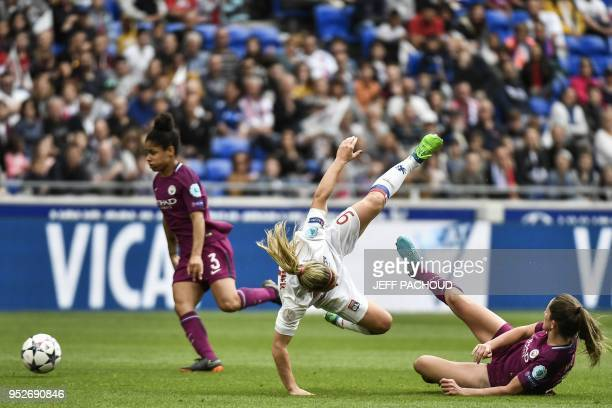 Lyon's French forward Eugenie le Sommer is tackled by Manchester City's British defender Abbie McManus during the UEFA Women's Champions League...