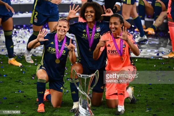 Lyon's French forward Eugenie Le Sommer , Lyon's French defender Wendie Renard and Lyon's French goalkeeper Sarah Bouhaddi celebrate after winning...