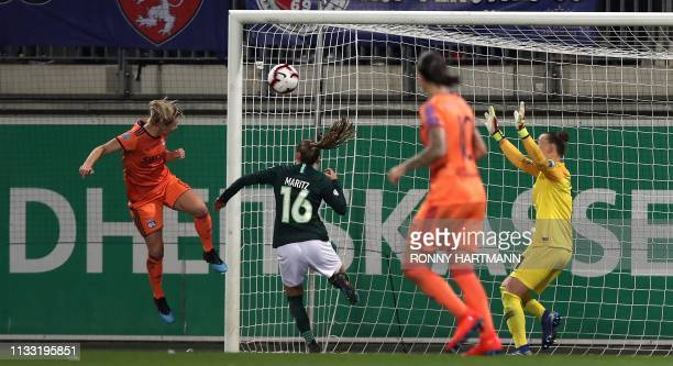 Lyon's French forward Eugenie Le Sommer scores the 23 goal during the UEFA women's Champions League quarterfinal secondleg football match between Vfl...