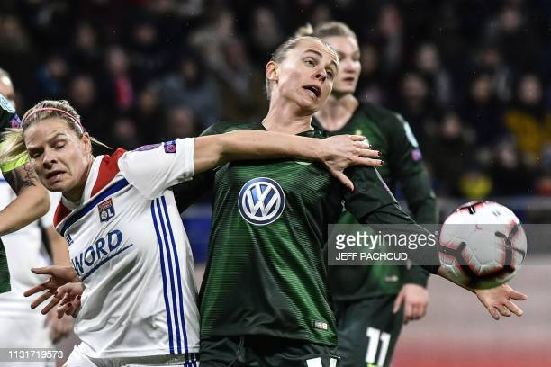 Lyon's French forward Eugenie Le Sommer vies with Wolfsburg's Swiss defender Noelle Maritz during the UEFA women's Champions League quarterfinal...