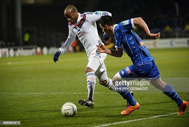 Lyon's French forward Jimmy Briand vies for the ball with Troyes' French defender Maximpe Colin during the French League Cup semifinal football match...