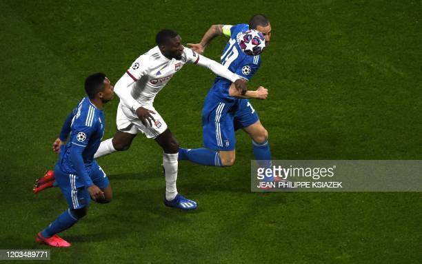 Lyon's French forward Karl Toko Ekambi vies for the ball with Juventus' Italian defender Leonardo Bonucci and Juventus' Brazilian defender Alex...