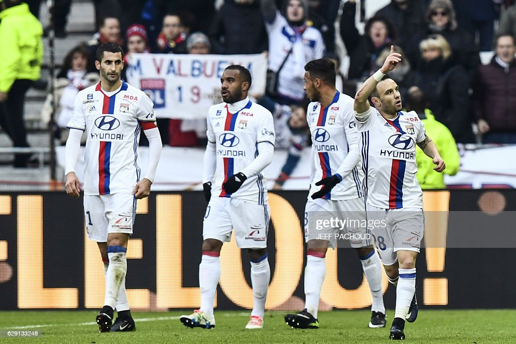 Lyon's French forward Mathieu Valbuena (R) celebrates after scoring a goal during the French L1 football match Olympique Lyonnais (OL) vs Rennes (Stade Rennais) on December 11, 2016, at the Parc Olympique Lyonnais stadium in Decines-Charpieu, central-eastern France. / AFP / JEFF