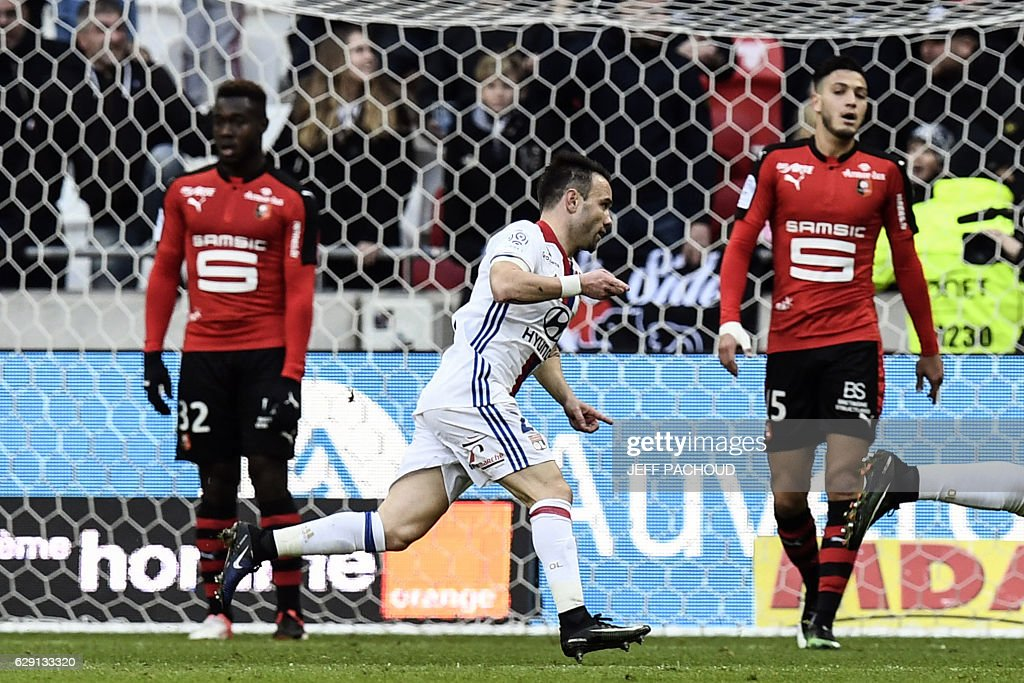 Lyon's French forward Mathieu Valbuena (C) celebrates after scoring a goal during the French L1 football match Olympique Lyonnais (OL) vs Rennes (Stade Rennais) on December 11, 2016, at the Parc Olympique Lyonnais stadium in Decines-Charpieu, central-eastern France.