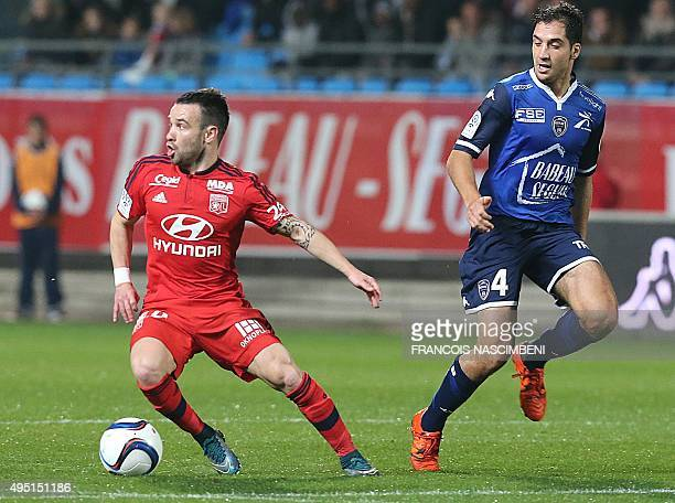 Lyon's French forward Mathieu Valbuena vies with Troyes' French midfielder Thomas Ayasse during the French L1 football match between Troyes and Lyon...