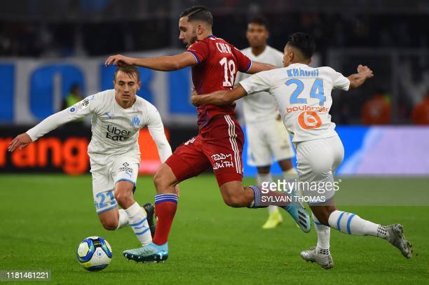 Lyon's French forward Mathis Rayan Cherki fights for the ball with Marseille's Tunisian midfielder Saif-Eddine Khaoui during the French L1 football...