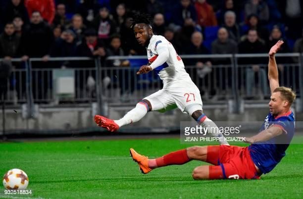 Lyon's French forward Maxwel Cornet kicks the ball during the Europa League football match Olympique Lyonnais vs CSKA Moscow on March 15 at the...