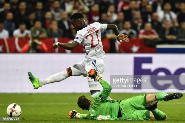 Lyon's French forward Maxwel Cornet vies with Besiktas' Spanish goalkeeper Fabricio Agosto Ramirez during the UEFA Europa League first leg quarter...