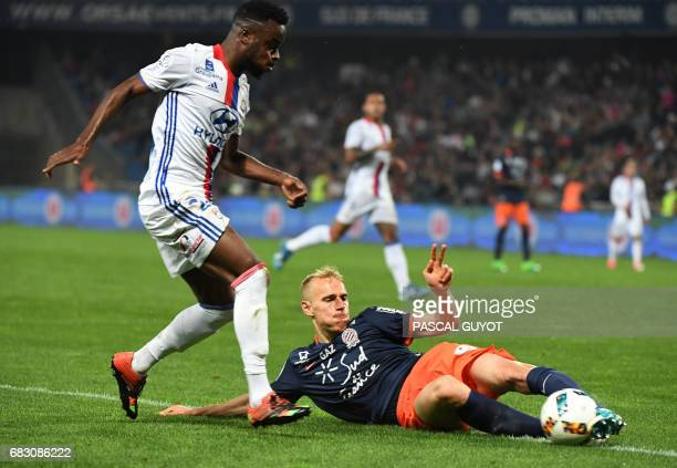 Lyon's French forward Maxwel Cornet vies with Montpellier's Czech defender Lukas Pokorny during the French L1 football match between Montpellier and...