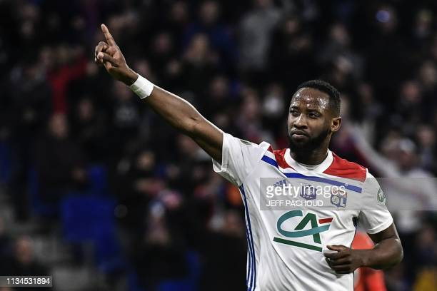 Lyon's French forward Moussa Dembele celebrates after scoring a penalty during French Cup semifinal football match between Olympique Lyonnais and...