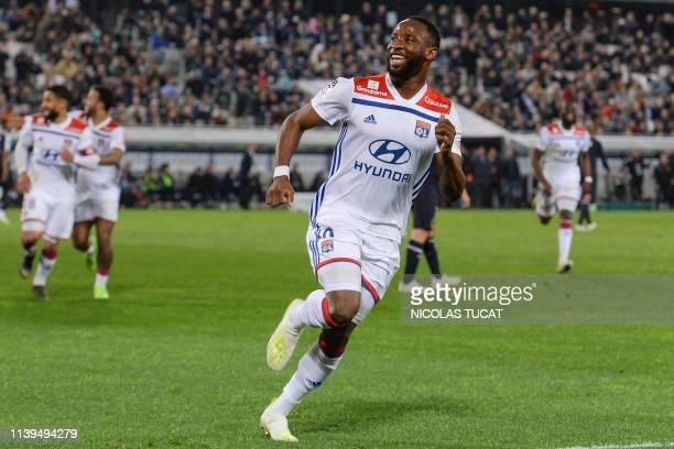 Lyon's French forward Moussa Dembele celebrates after scoring a goal during the French L1 football match between Bordeaux and Lyon on April 26 2019...