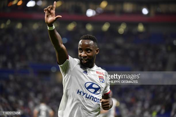 Lyon's French forward Moussa Dembele celebrates after scoring a goal during the French L1 football match between Olympique Lyonnais and Angers SCO on...