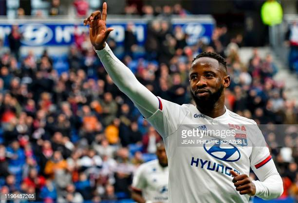Lyon's French forward Moussa Dembele celebrates after scoring a goal during the French L1 football match between Lyon and Toulouse on January 26 2020...
