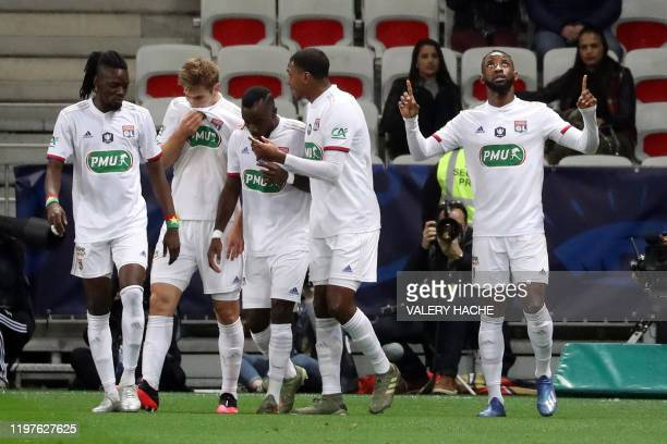 Lyon's French forward Moussa Dembele celebrates after scoring a goal during the French Cup round-of-16 football match between OGC Nice and Olympique...