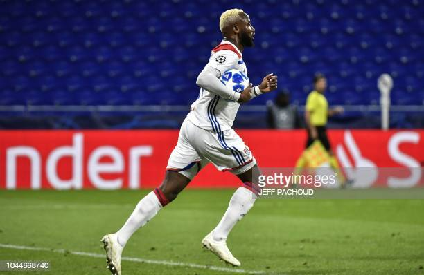 Lyon's French forward Moussa Dembele celebrates after scoring during their UEFA Champions League Group F football match Olympique Lyonnais vs FC...