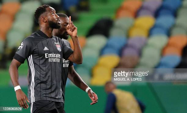 Lyon's French forward Moussa Dembele celebrates scoring his team's second goal during the UEFA Champions League quarter-final football match between...