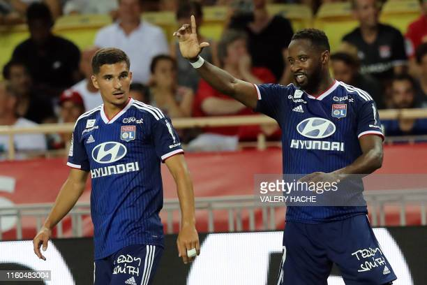 Lyon's French forward Moussa Dembele gestures after scoring a goal during the French L1 football match between AS Monaco and Olympique Lyonnais at...