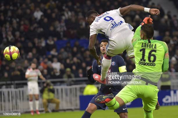 Lyon's French forward Moussa Dembele heads the ball prior to score a goal during the French L1 football match between Olympique Lyonnais and...