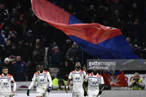 Lyon's French forward Moussa Dembele jubilates after scoring a goal during the French L1 football match between Olympique Lyonnais and ParisSaint...