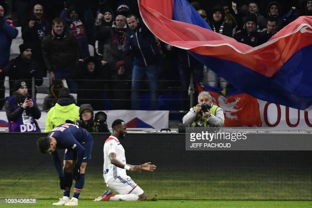 Lyon's French forward Moussa Dembele knees as he jubilates after scoring a goal during the French L1 football match between Olympique Lyonnais and...