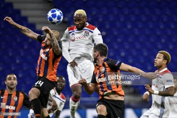 Lyon's French forward Moussa Dembele scores a goal despite Donetsk's Ukrainian defender Yaroslav Rakitskiy during their UEFA Champions League Group F...