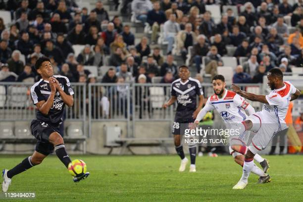 Lyon's French forward Moussa Dembele scores a goal during the French L1 football match between Bordeaux and Lyon on April 26 2019 at the Matmut...