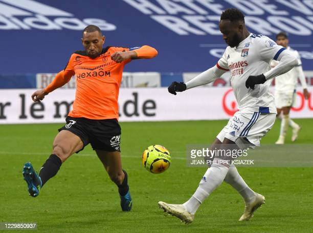 Lyon's French forward Moussa Dembele scores a goal during the French L1 football match between Lyon and Reims on November 29 2020 at the Groupama...