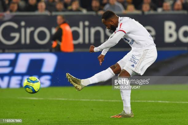 Lyon's French forward Moussa Dembele shoots and scores a goal during the French L1 football match between FC Girondins de Bordeaux and Olympique...