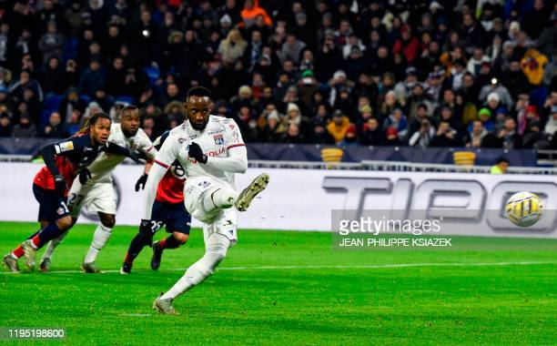 Lyon's French forward Moussa Dembele shoots and scores a penalty kick during the French League Cup semifinal football match between Olympique...