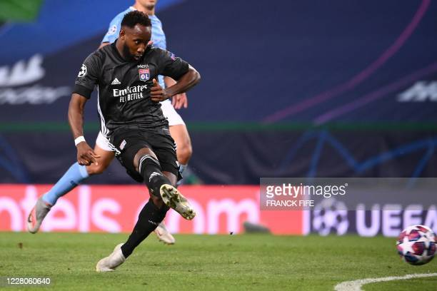 Lyon's French forward Moussa Dembele shoots and scores his team's second goal during the UEFA Champions League quarter-final football match between...