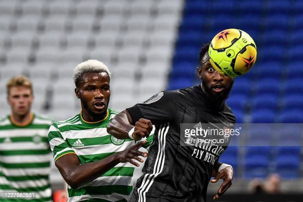 Lyon's French forward Moussa Dembele vies for the ball with Celtic FC's Belgian defender Boli BolingoliMbombo during a Lyonhosted friendly tournament...