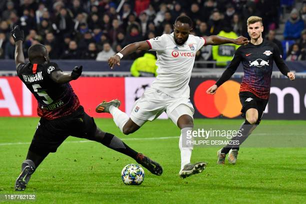 Lyon's French forward Moussa Dembele vies with RB Leipzig's French defender Dayot Upamecano during the UEFA Champions League group G football match...