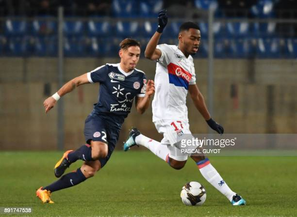Lyon's French forward Myziane Maolida vies with Montpellier's French defender Ruben Aguilar during the French League Cup round of 16 football match...