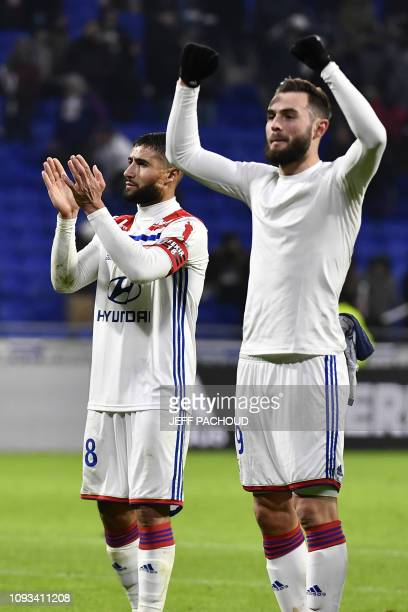 Lyon's French forward Nabil Fekir and Lyon's French midfielder Lucas Tousart cheer supporters at the end of the French L1 football match between...