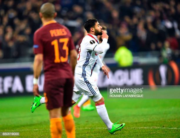 Lyon's French forward Nabil Fekir celebrates after scoring a goal during the Europa League round of 16 first leg football match between Lyon and AS...